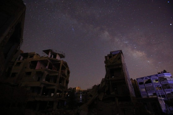 A picture shows the Milky Way as seen from thee rebel-held town of Douma, east of the Syrian capital Damascus, on June 6, 2016, on the first day of the holy month of Ramadan. More than a billion Muslims observed the start of Ramadan but in the besieged cities of Syria and Iraq residents struggled to mark the holy month. Islamic authorities announced the start of the fasting month with the sighting of the crescent moon in countries such as Indonesia and Saudi Arabia. / AFP PHOTO / Sameer Al-Doumy