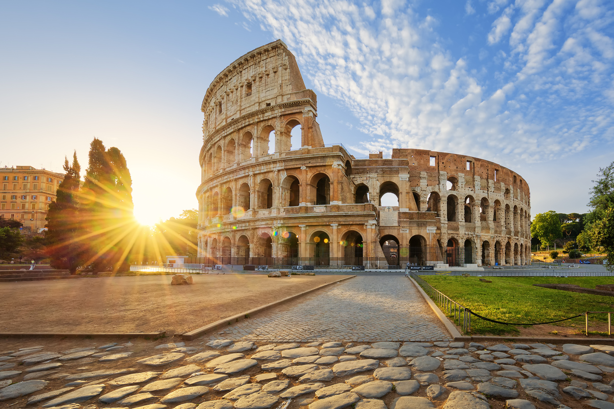 View of Colosseum in Rome and morning sun, Italy, Europe.