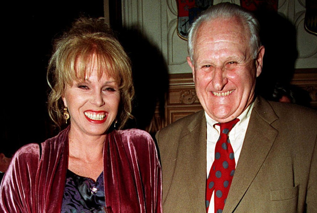 "FILE - In this April 29, 1998 file photo, actress Joanna Lumley, left and actor Peter Vaughan, pose for a photo, in London. Veteran British character actor Peter Vaughan, who played the enigmatic Maester Aemon in ""Game of Thrones,"" has died aged 93. Vaughan's agent Sally Long-Innes says he died Tuesday, Dec. 6, 2016 surrounded by his family. (Fiona Hanson/PA via AP, File)"
