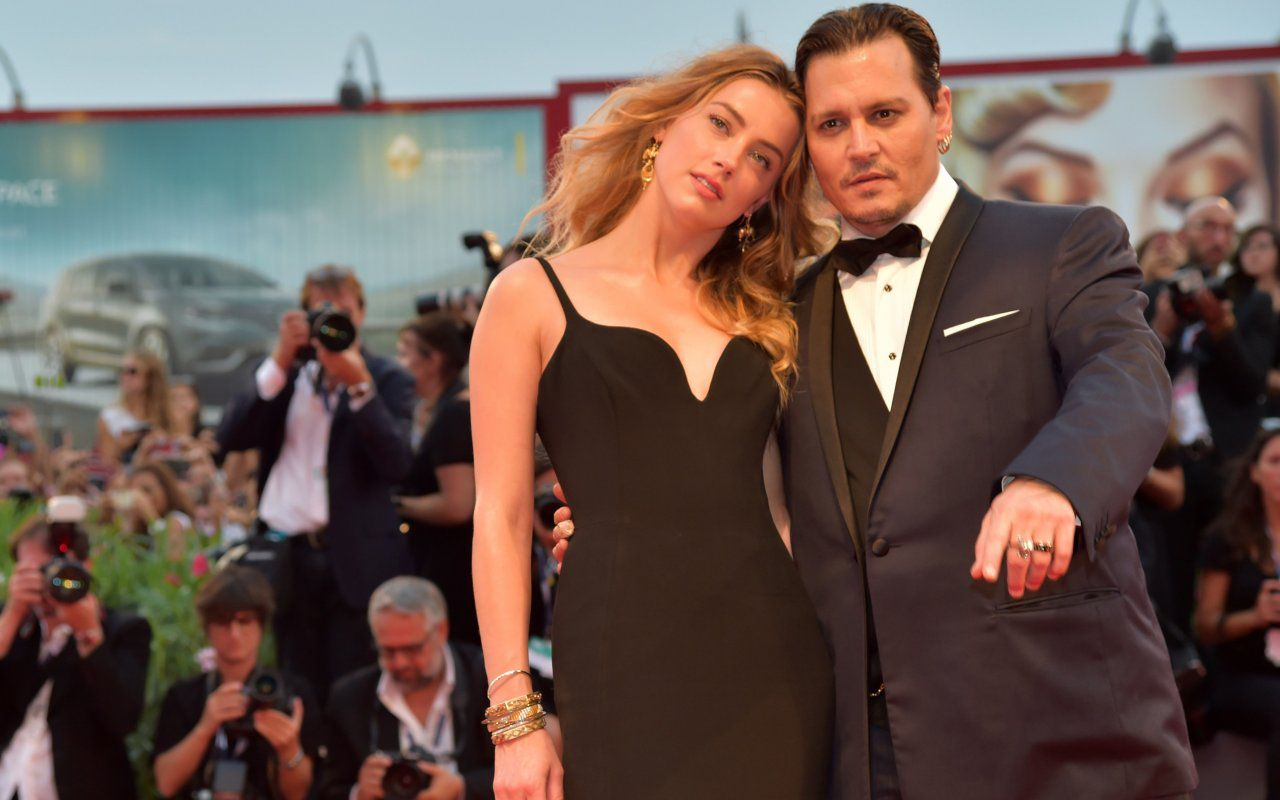 Johnny Depp e la moglie Amber Heard: red carpet alla Mostra del cinema di Venezia