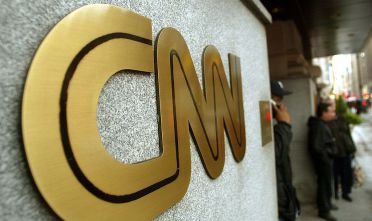 NEW YORK - NOVEMBER 12:  The CNN sign is seen outside its headquarters November 12, 2002 in New York City. The proposed merger between CNN and Walt Disney Co.'s ABC News is progressing and could reach an agreement on principle by January, according to negotiators close to the deal.  (Photo by Mario Tama/Getty Images)