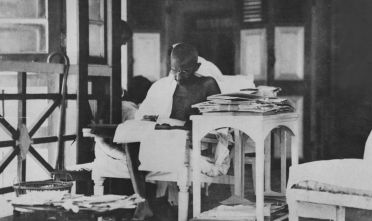 20th May 1924:  Indian statesman Mahatma Gandhi (Mohandas Karamchand Gandhi, 1869 - 1948) reading his correspondance whilst living in seclusion after being released from prison.  (Photo by Topical Press Agency/Getty Images)