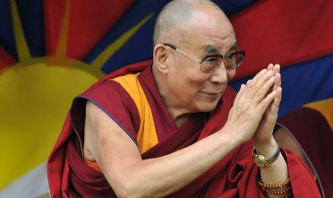 GLASTONBURY, ENGLAND - JUNE 28:  His holiness the Dalai Lama attends the third day of Glastonbury Festival at Worthy Farm, Pilton on June 28, 2015 in Glastonbury, England.  (Photo by Jim Dyson/Getty Images)