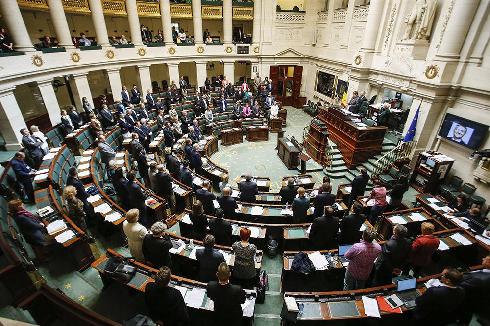 Members of the chamber of the Belgian federal parliament building observe a minute of silence for deceased Minister of State, Steve Stevaert, on April 30, 2015 in Brussels. Stevaert was found deceased on April 2, following rape and indecent assault allegations. AFP PHOTO / BELGA / THIERRY ROGE **Belgium out**        (Photo credit should read THIERRY ROGE/AFP/Getty Images)