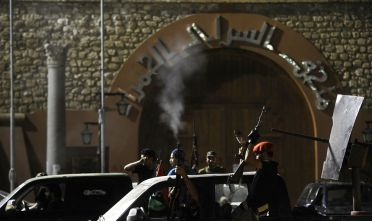 Rebel fighters fire in the air as they celebrate in the newly named Martyr's Square, formerly known as Green Square, after rebel forces overran Libyan leader Moamer Kadhafi's fortified Bab al-Azizya headquarters in the capital Tripoli, following heavy fighting on August 23, 2011. AFP PHOTO/FILIPPO MONTEFORTE (Photo credit should read FILIPPO MONTEFORTE/AFP/Getty Images)