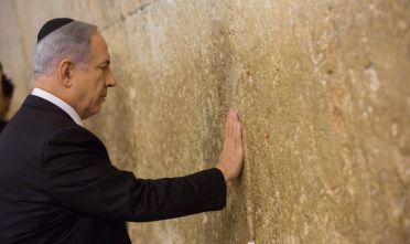 "19 Mar 2015, Jerusalem, Israel --- (150318) -- JERUSALEM, March 18, 2015 (Xinhua) -- Israeli Prime Minister Benjamin Netanyahu prays at the Jewish site of the Western Wall in the Old City of Jerusalem, on March 18, 2015. Incumbent Israeli Prime Minister Benjamin Netanyahu said on Wednesday he's ""exhilarated"" to be elected for another term in office, following results crowning him the winner of Tuesday's elections. Netanyahu visited the Jewish site of the Western Wall here on Wednesday, after 99.7 percent of the votes showed the L --- Image by © JINI/Xinhua Press/Corbis"