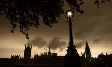 LONDON, ENGLAND - OCTOBER 16: A street lamp is lit opposite the Houses of Parliament during a reddish sky caused by remnants of Hurricane Ophelia dragging in dust from the Sahara Desert, on October 16, 2017 in London, England. The hurricane comes exactly 30 years after the Great Storm of 1987 which killed 18 people and is estimated to have caused 1bn GBP in damage to property and infrastructure.  (Photo by Carl Court/Getty Images  (Photo by Carl Court/Getty Images)