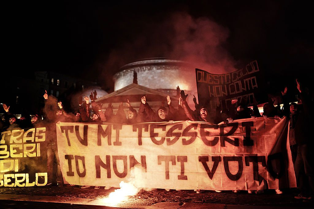 """NAPOLI, ITALY - 2013/02/24: Napoli football team supporters protest against the political elections because of the law for """"supporter's card"""" (tessera del tifoso) by former minister Roberto Maroni of the Berlusconi's government, burning and ripping their voting card in Piazza del Plebiscito, in front of the Prefettura palace. (Photo by Andrea Baldo/LightRocket via Getty Images)"""