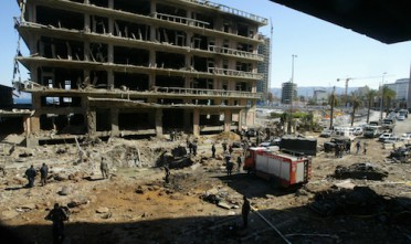 The scene of the damage area where a massive car bomb blew up the motorcade of former prime ...