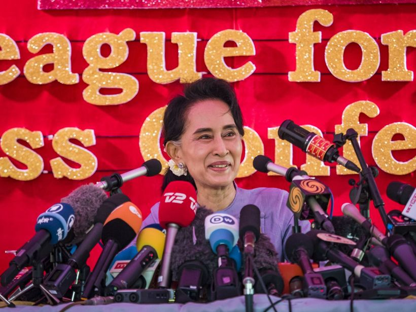 05 Nov 2015, Yangon, Burma --- Nov. 5, 2015 - Yangon, Yangon Division, Myanmar - AUNG SAN SUU KYI smiles during a press conference. During the press conference, which lasted 90 minutes, Aung San Suu Kyi, the leader of the National League for Democracy (NLD), said that if the NLD won the election she would serve ''above'' the President. When questioned about the Rohingya crisis in western Myanmar, a reporter called the situation ''dramatic'' and Suu Kyi replied the entire country is in a ''dramatic situation'' and the problems of the Rohingya should not be ''exaggerated.'' She said the ''great majority of our people remain as poor as ever.'' She also said the NLD would make a ''fuss'' if election results were ''suspicious.'' Citizens of Myanmar go to the polls Sunday November 8 in what is widely viewed as the most democratic and contested election in Myanmar's history. The NLD is widely expecte --- Image by © Jack Kurtz/ZUMA Press/Corbis