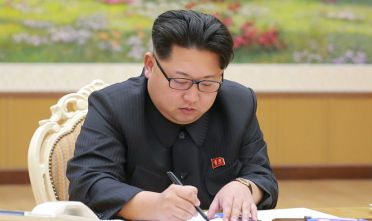 07 Jan 2016, North Korea --- (160107) -- PYONGYANG, Jan. 7, 2016 (Xinhua) -- Photo provided by the Korean Central News Agency (KCNA) on Jan. 7, 2016 shows top leader of the Democratic People's Republic of Korea (DPRK) Kim Jong Un signing the final written order of the hydrogen bomb test on Jan. 3, 2016. Kim Jong Un ordered the H-bomb test on Dec. 15, 2015, and signed the final written order on Sunday. (Xinhua/KCNA) --- Image by © KCNA/Xinhua Press/Corbis