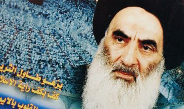 """KARBALA, IRAQ - JANUARY 17:  Posters of Grand Ayatollah Ali Sistani, Iraq's pre-eminent Shiite Muslim cleric, are seen January 17, 2004 in the holy Shia city of Karbala, Iraq.  Sistani has sparked a crisis by rejecting U.S. plans for Iraq and calling for early elections. Once known as a """"quietist"""" cleric that rarely intervened in political affairs, Sistani is moving aggressively to ensure that Iraq's Shiite majority of 60% is represented in any new government. (Photo by Scott Peterson/Getty Images)"""