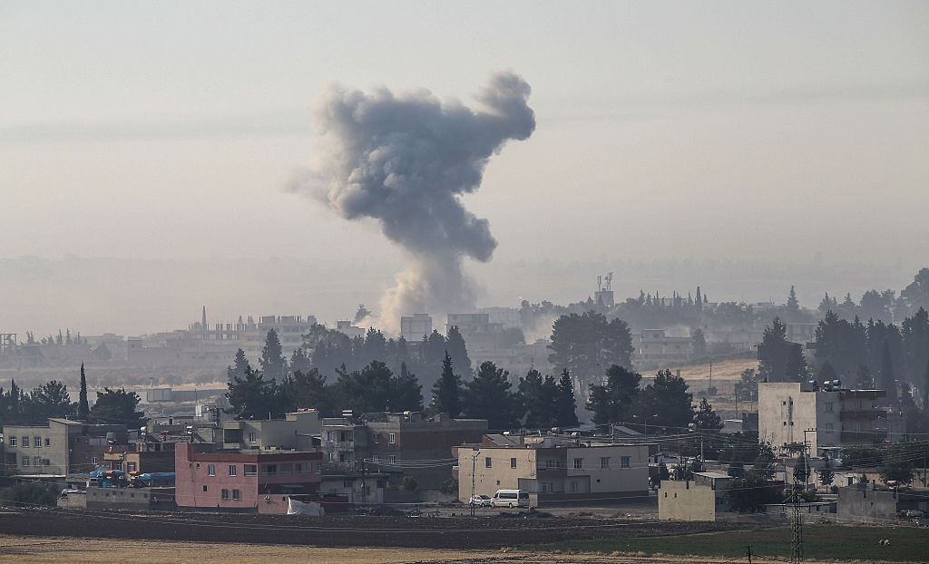 """GAZIANTEP, TURKEY - AUGUST 24: The photo taken from Karkamis district of the Turkey's Gaziantep province shows smoke rising as the Turkish fighter jets bomb Daesh targets during the """"Operation Euphrates Shield"""" in Jarabulus, Syria on August 24, 2016. The anti-Daesh operation, called Euphrates Shield, is aimed at clearing terrorist groups from the Turkish border region, tightening border security, and supporting Syrias territorial integrity. (Photo by Cem Ozdel/Anadolu Agency/Getty Images)"""