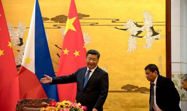 BEIJING, CHINA - OCTOBER 20: Philippine President Rodrigo Duterte, right is shown the way by Chinese President Xi Jinping before a signing ceremony on October 20, 2016 in Beijing, China. Philippine president Rodrigo Duterte is on a four-day state visit to China, his first since taking power in late June, with the aim of improving bilaterial relations.  (Photo by Ng Han Guan-Pool/Getty Images)