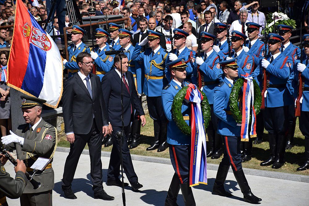 BELGRAD, SERBIA - AUGUST 19:  On the 100th anniversary of the Battle of Cer, President of Republika Srpska Milorad Dodik (rear R), Prime Minister of Serbia Aleksandar Vucic (rear L), and many citizens attend commemoration ceremony of Serbian soldiers who died at Battle of Cer in Belgrad, Serbia on 19 August, 2014. (Photo by Kristina Maslarevic/Anadolu Agency/Getty Images)