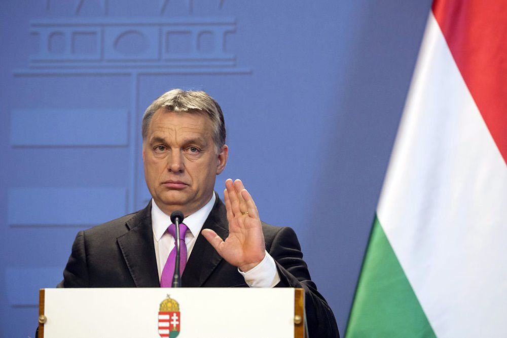 """Viktor Orban, Hungary's prime minister, gestures during a joint news conference with David Cameron, U.K. prime minister, in Budapest, Hungary, on Thursday, Jan. 7, 2016. On the euro, Cameron said that while Britain wants the shared currency to be a success, he wants to ensure """"that we're not called upon to support the euro zone financially."""". Photographer: Balazs Mohai/Bloomberg via Getty Images"""