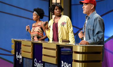 "SATURDAY NIGHT LIVE -- ""Tom Hanks"" Episode 1708 -- Pictured: (l-r) Sasheer Zamata as Keely, Leslie Jones as Shanice, and Tom Hanks as Doug during the ""Black Jeopardy"" sketch on October 22, 2016 -- (Photo by: Will Heath/NBC/NBCU Photo Bank via Getty Images)"