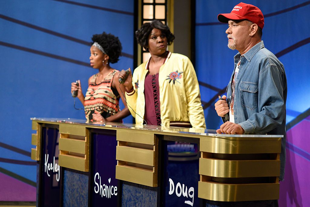 """SATURDAY NIGHT LIVE -- """"Tom Hanks"""" Episode 1708 -- Pictured: (l-r) Sasheer Zamata as Keely, Leslie Jones as Shanice, and Tom Hanks as Doug during the """"Black Jeopardy"""" sketch on October 22, 2016 -- (Photo by: Will Heath/NBC/NBCU Photo Bank via Getty Images)"""