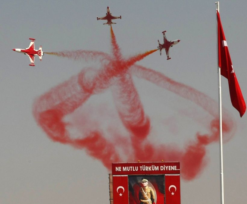 Turkish Stars, the aerobatic team of the Turkish Air Force, perform a manoeuvre during a ceremony marking the 88th anniversary of the Victory Day commemorating the victory in the Battle of Dumlupinar, the final battle in the Turkish War of Independence in 1922, in Ankara on August 30, 2010. AFP PHOTO/ADEM ALTAN (Photo credit should read ADEM ALTAN/AFP/Getty Images)