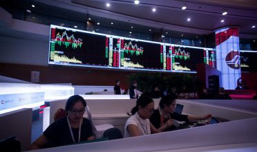 Women work on the trading floor at the Shanghai Stock Exchange in the Lujiazui Financial district of Shanghai on  September 22, 2015.  AFP PHOTO / JOHANNES EISELE        (Photo credit should read JOHANNES EISELE/AFP/Getty Images)