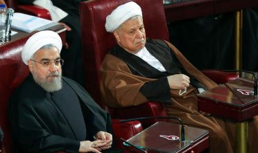 TEHRAN, IRAN - MARCH 10: Iranian President Hassan Rouhani (L) and former Iranian President and current  chairman of the Expediency Discernment Council, Hashemi Rafsanjani (R) are seen during Iranian Assembly of Experts chairman election at the parliament in Tehran, Iran on March 10, 2015. Ayatollah Yazdi won the Assembly of Experts chairman election with 47 votes. (Photo by Fatemeh Bahrami/Anadolu Agency/Getty Images)