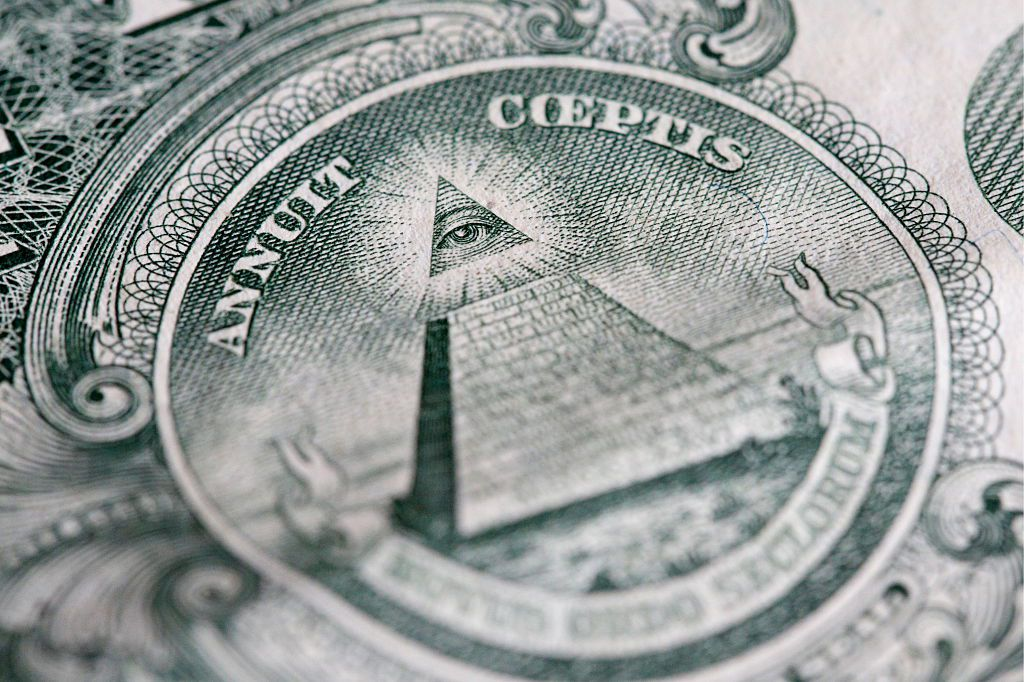 The reverse of the United States one-dollar bill depicting a Pyramid with 13 steps and the Eye of Providence. (Photo by: Godong/UIG via Getty Images)