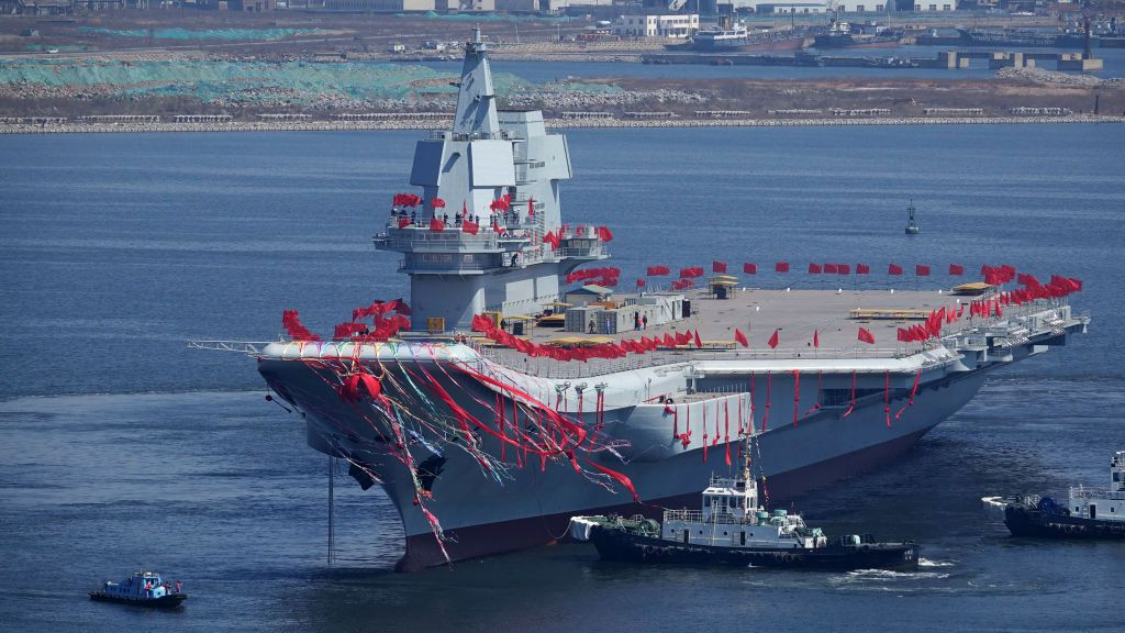 Type 001A, China's second aircraft carrier, is seen during a launch ceremony at Dalian shipyard in Dalian, northeast China's Liaoning Province, April 26, 2017.                                   China has launched its first domestically designed and built aircraft carrier, state media said on April 26, as the country seeks to transform its navy into a force capable of projecting power onto the high seas.  / AFP PHOTO / STR / CHINA OUT        (Photo credit should read STR/AFP/Getty Images)