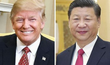 U.S. President Donald Trump (L) and Chinese President Xi Jinping, seen in this undated combined photo, held talks over the phone on April 12, 2017. The two leaders agreed to maintain a close dialogue after discussing rising tensions around the North Korea and Syria situations. (Kyodo) ==Kyodo (Photo by Kyodo News via Getty Images)