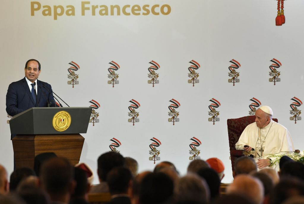 Pope Francis (R) listens as Egyptian President Abdel Fattah al-Sisi delivers a speech during a meeting in Cairo on April 28, 2017. Francis, who started a two-day visit, has said he hoped his trip would contribute to dialogue with Muslims and show support for Egypt's Coptic Christians. / AFP PHOTO / Andreas SOLARO        (Photo credit should read ANDREAS SOLARO/AFP/Getty Images)