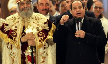 Egyptian President Abdel Fattah el-Sisi (C) speaks as Egyptian Coptic Christian religious leader Pope Tawadros II (L) looks on during Christmas celebration at the Coptic Cathedral in Cairo's Abbassiya neighborhood on January 6, 2015. Many Coptic Christians celebrate Christmas Day near January 7 to remember Jesus Christs birth, as described in the Christian Bible. AFP PHOTO / AHMED GAMEL        (Photo credit should read AHMED GAMEL/AFP/Getty Images)