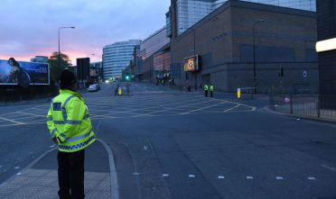 Police stand guard at the scene of a suspected terrorist attack during a pop concert by US star Ariana Grande in Manchester, northwest England on May 23, 2017. / AFP PHOTO / PAUL ELLIS        (Photo credit should read PAUL ELLIS/AFP/Getty Images)