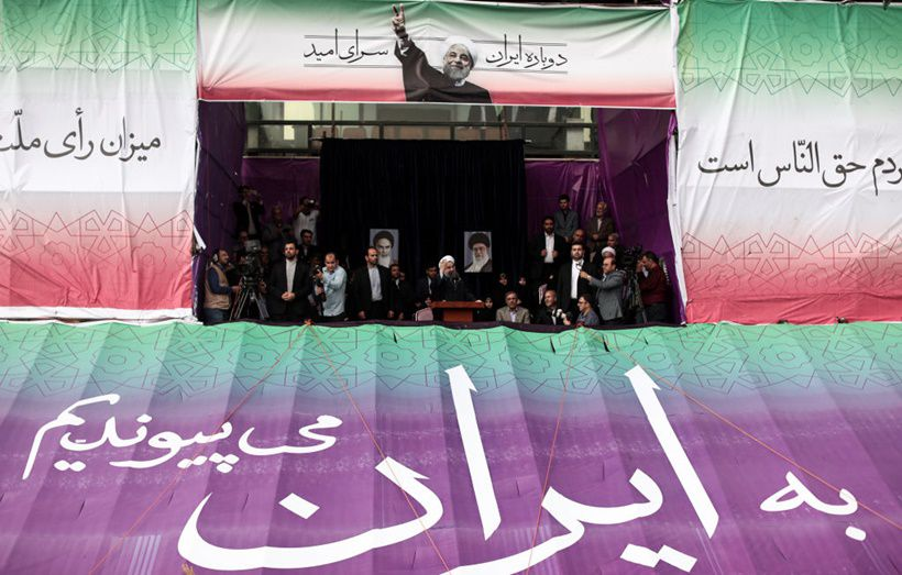 Iranian President and candidate in the upcoming presidential elections Hassan Rouhani gives an address at a campaign rally in Takhti stadium in the northeastern city of Mashhad on May 17, 2017. Iran's presidential election on May 19 is effectively a choice between moderate incumbent Hassan Rouhani and hardline jurist Ebrahim Raisi, with major implications for everything from civil rights to relations with Washington. / AFP PHOTO / Behrouz MEHRI        (Photo credit should read BEHROUZ MEHRI/AFP/Getty Images)