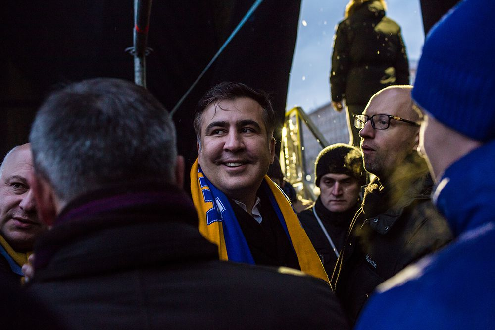 KIEV, UKRAINE - DECEMBER 7: Mikheil Saakashvili, the former president of Georgia, waits back stage just before speaking to anti-government protesters on Independence Square on December 7, 2013 in Kiev, Ukraine. Thousands of people have been protesting against the government since a decision by Ukrainian president Viktor Yanukovych to suspend a trade and partnership agreement with the European Union in favor of incentives from Russia. (Photo by Brendan Hoffman/Getty Images)