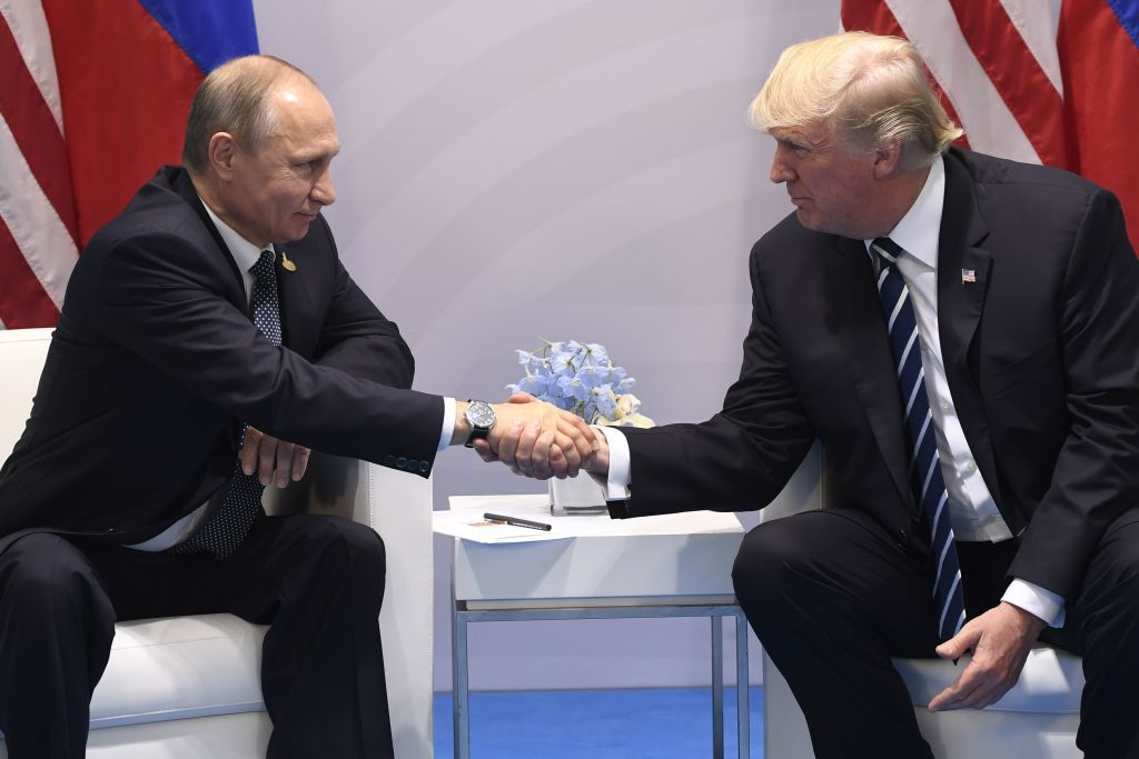 US President Donald Trump and Russia's President Vladimir Putin shake hands during a meeting on the sidelines of the G20 Summit in Hamburg, Germany, on July 7, 2017. / AFP PHOTO / SAUL LOEB        (Photo credit should read SAUL LOEB/AFP/Getty Images)