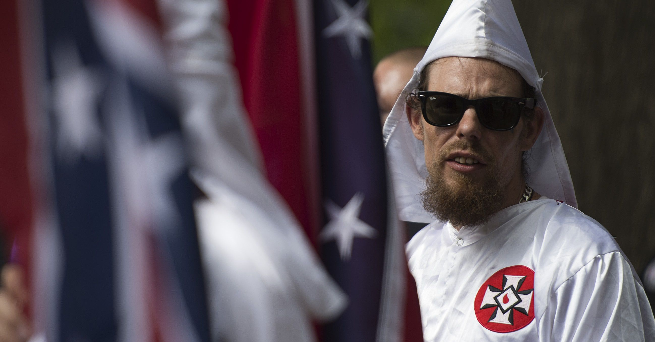 A member of the Ku Klux Klan looks on during a rally, calling for the protection of Southern Confederate monuments, in Charlottesville, Virginia on July 8, 2017. The afternoon rally in this quiet university town has been authorized by officials in Virginia and stirred heated debate in America, where critics say the far right has been energized by Donald Trump's election to the presidency.  / AFP PHOTO / ANDREW CABALLERO-REYNOLDS        (Photo credit should read ANDREW CABALLERO-REYNOLDS/AFP/Getty Images)