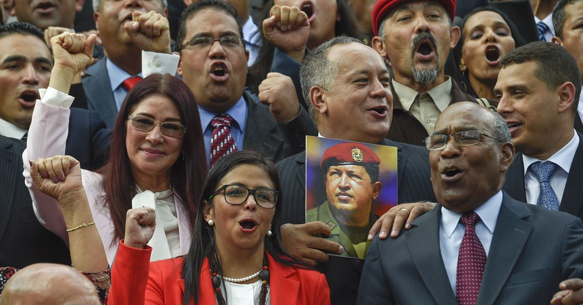 (L to R) Members of the Constituent Assembly Cilia Flores, Delcy Rodriguez, Diosdado Cabello and Aristobulo Isturiz pose with a picture of late Venezuelan President Hugo Chavez during the Assembly's installation at the National Congress in Caracas on August 4, 2017. Venezuelan President Nicolas Maduro installed a powerful new assembly packed with his allies, dismissing an international outcry and opposition protests saying he is burying democracy in his crisis-hit country. / AFP PHOTO / JUAN BARRETO        (Photo credit should read JUAN BARRETO/AFP/Getty Images)
