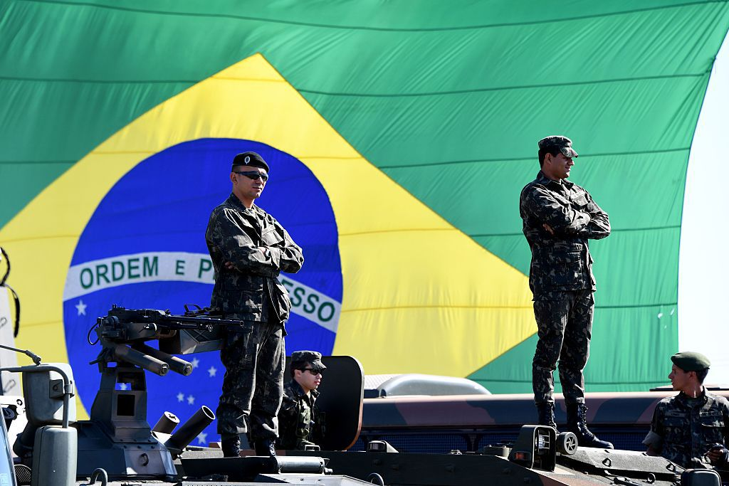 Brazilian soldiers participate in the ceremony to present the integrated security forces for the ten Rio 2016 Olympic Games football matches that will be played at the Mane Garrincha national Stadium in Brasilia, on 22 July 20016.  The security of the Olympic matches will be taken in charge from next Sunday on by 4,500 agents, between soldiers, police officers, firefighters and Traffic department personnel  / AFP / EVARISTO SA        (Photo credit should read EVARISTO SA/AFP/Getty Images)