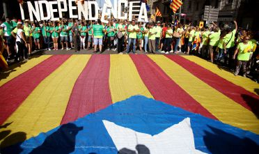 BARCELONA, SPAIN - SEPTEMBER 11:  People march during a demonstration celebrating the Catalan National Day on September 11, 2017 in Barcelona, Spain. The Spanish Northeastern autonomous region celebrates its National Day on September 11 marked by the secession referendum of the next October 1 which was approved by the Catalan Parliament and banned by the Spanish Government.  (Photo by Sandra Montanez/Getty Images)