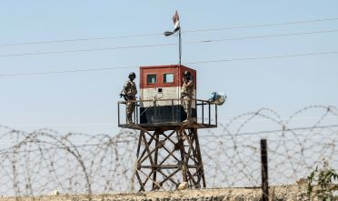 A picture taken on August 23, 2017 from the southern Gaza Strip town of Rafah shows Egyptian soldiers standing guard in a watch tower across the border between Gaza and Egypt. / AFP PHOTO / SAID KHATIB        (Photo credit should read SAID KHATIB/AFP/Getty Images)