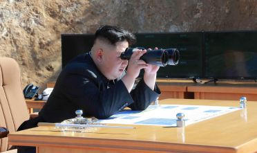 "This picture taken and released on July 4, 2017 by North Korea's official Korean Central News Agency (KCNA) shows North Korean leader Kim Jong-Un inspecting the test-fire of intercontinental ballistic missile Hwasong-14 at an undisclosed location. North Korea declared on July 4 it had successfully tested its first intercontinental ballistic missile -- a watershed moment in its push to develop a nuclear weapon capable of hitting the mainland United States. / AFP PHOTO / KCNA VIA KNS / STR / South Korea OUT / REPUBLIC OF KOREA OUT   ---EDITORS NOTE--- RESTRICTED TO EDITORIAL USE - MANDATORY CREDIT ""AFP PHOTO/KCNA VIA KNS"" - NO MARKETING NO ADVERTISING CAMPAIGNS - DISTRIBUTED AS A SERVICE TO CLIENTS THIS PICTURE WAS MADE AVAILABLE BY A THIRD PARTY. AFP CAN NOT INDEPENDENTLY VERIFY THE AUTHENTICITY, LOCATION, DATE AND CONTENT OF THIS IMAGE. THIS PHOTO IS DISTRIBUTED EXACTLY AS RECEIVED BY AFP.   /         (Photo credit should read STR/AFP/Getty Images)"