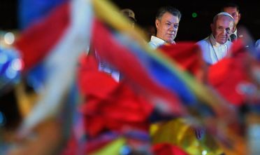 """Pope Francis (R) and Colombia's President Juan Manuel Santos attend a farewell ceremony at the Rafael Nunez airport in Cartagena on September 10, 2017.  Pope Francis prayed Sunday for a peaceful end to Venezuela's """"grave crisis"""" which has left scores dead, as he wrapped up a tour to support peace in neighboring Colombia. / AFP PHOTO / Luis Acosta        (Photo credit should read LUIS ACOSTA/AFP/Getty Images)"""