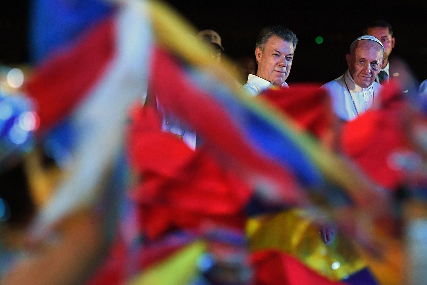 "Pope Francis (R) and Colombia's President Juan Manuel Santos attend a farewell ceremony at the Rafael Nunez airport in Cartagena on September 10, 2017.  Pope Francis prayed Sunday for a peaceful end to Venezuela's ""grave crisis"" which has left scores dead, as he wrapped up a tour to support peace in neighboring Colombia. / AFP PHOTO / Luis Acosta        (Photo credit should read LUIS ACOSTA/AFP/Getty Images)"