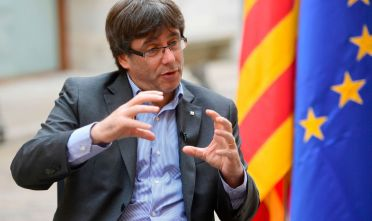 Catalan president Carles Puigdemont gestures during an AFP interview in Girona on September 30, 2017. The mission was entrusted to him almost by accident, but he accomplished it with determination. Deaf to the warnings of Madrid, the Catalan regional president Carles Puigdemont is determined to organize a referendum on October 1, 2017, hoping to fulfill his dream of youth: an independent Catalonia. / AFP PHOTO / PIERRE-PHILIPPE MARCOU / TO GO WITH AFP INTERVIEW by DANIEL BOSQUE        (Photo credit should read PIERRE-PHILIPPE MARCOU/AFP/Getty Images)