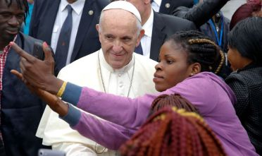 Pope Francis poses for a selfie with a woman as he visits a migrant reception centre during a pastoral visit in Bologna, on October 1, 2017.  / AFP PHOTO / POOL / ALESSANDRO BIANCHI        (Photo credit should read ALESSANDRO BIANCHI/AFP/Getty Images)