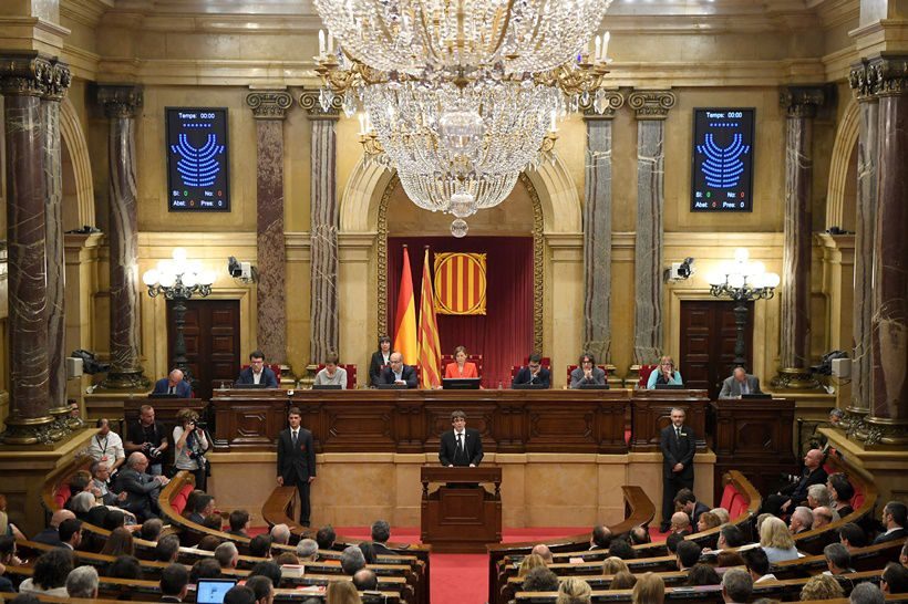 Catalan regional government president Carles Puigdemont (C) gives a speech at the Catalan regional parliament in Barcelona on October 10, 2017. Spain's worst political crisis in a generation will come to a head as Catalonia's leader could declare independence from Madrid in a move likely to send shockwaves through Europe.  / AFP PHOTO / LLUIS GENE        (Photo credit should read LLUIS GENE/AFP/Getty Images)