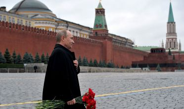 Russian President Vladimir Putin carries flowers before a ceremony at the Red square in Moscow on November 4, 2012, during the National Unity Day, a national holiday which this year marks the 400th anniversary of the 1612 expulsion of Polish occupiers from the Kremlin. The Russian president has been facing a nascent protest movement against his rule since an election that returned him to the Kremlin for a third term in May, and the anti-Putin cause has become popular with ultra-nationalists. AFP PHOTO/RIA-NOVOSTI/POOL/ALEXEI NIKOLSKY        (Photo credit should read ALEXEI NIKOLSKY/AFP/Getty Images)
