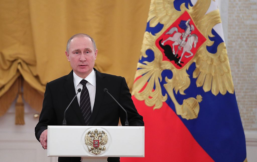 Russian President Vladimir Putin delivers a speech during a reception dedicated to the celebration of the New Year at the Kremlin in Moscow on December 28, 2016. / AFP / Sputnik / Michael Klimentyev        (Photo credit should read MICHAEL KLIMENTYEV/AFP/Getty Images)