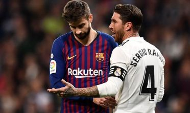 Real Madrid's Spanish defender Sergio Ramos (R) talks with Barcelona's Spanish defender Gerard Pique during the Spanish league football match between Real Madrid CF and FC Barcelona at the Santiago Bernabeu stadium in Madrid on March 2, 2019. (Photo by OSCAR DEL POZO / AFP)        (Photo credit should read OSCAR DEL POZO/AFP/Getty Images)