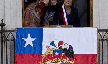 The new Chilean President Michelle Bachelet waves from a balcony at La Moneda presidential Palace, in Santiago, Chile, on March 11, 2014. Bachelet took the oath of office as president of Chile, returning to power after four years with a reform agenda to reduce social disparities in this prosperous South American country.      AFP PHOTO/MARTIN BERNETTI        (Photo credit should read MARTIN BERNETTI/AFP/Getty Images)