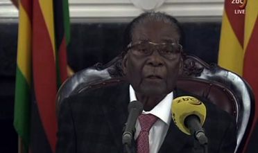 "TOPSHOT - A video grab made on November 19, 2017 from footage of the broadcast of Zimbabwe Broadcasting corporation (ZBC) shows Zimbabwe's President Robert Mugabe delivering a speech in Harare, following a meeting with army chiefs who have seized power in Zimbabwe. Zimbabwean President Robert Mugabe, in a much-expected TV address, stressed he was still in power after his authoritarian 37-year reign was rocked by a military takeover. Many Zimbabweans expected Mugabe to resign after the army seized power last week. But Mugabe delivered his speech alongside the uniformed generals who were behind the military intervention. In his address, Mugabe made no reference to the clamour for him to resign.   / AFP PHOTO / ZBC AND AFP PHOTO / STR / XGTY / RESTRICTED TO EDITORIAL USE - MANDATORY CREDIT ""AFP PHOTO / ZBC"" - NO MARKETING NO ADVERTISING CAMPAIGNS - DISTRIBUTED AS A SERVICE TO CLIENTS        (Photo credit should read STR/AFP/Getty Images)"
